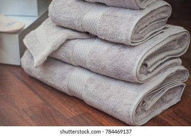 closeup of grey bath towels pile in decoration store