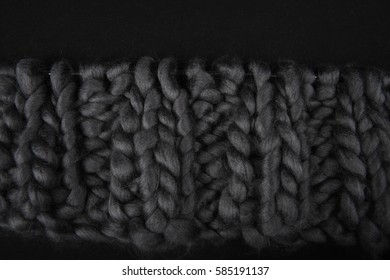 Closeup of grey chunky wool.  Knit and purl knitting stitches. Copy space in upper part of image.