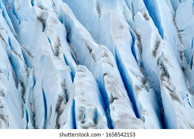 Close-up of the Grey Glacier, a gigantic glacier in Torres del Paine National Park, Patagonia, Chile. Crags and crevasses in the ice clearly showing. Blue ice.