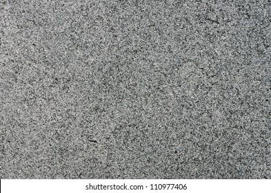 Closeup of grey granite texture background.