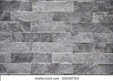 A Close-up of a grey stone wall background texture.