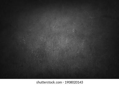 Close-up of grey textured concrete. Dark edges