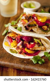 Closeup of grilled chicken and vegetable fajitas.