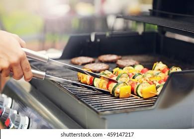 Closeup of grilled shashliks on grate
