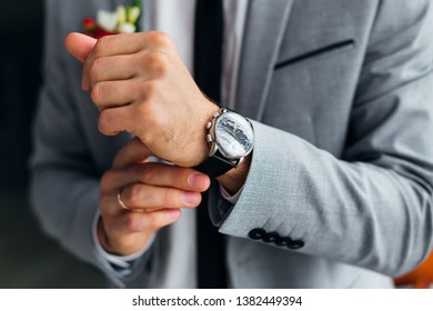 close-up of groom hand with a wristwatch. stylish watch
