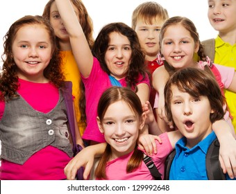 Close-up of a group of 8 kids together with backpacks, smiling, laughing, on white