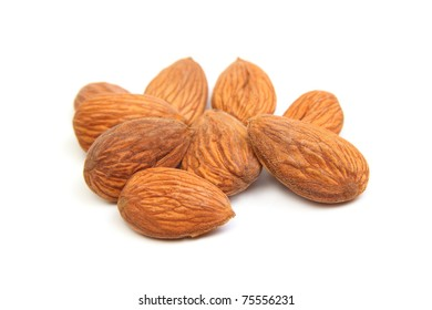 Close-up of group of almond kernels isolated on white