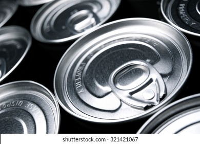 Closeup of a group of aluminium cans.
