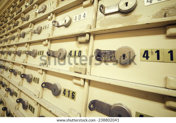 Closeup of a group of cells in an old safe bank.
