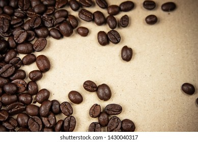 Closeup group of coffee bean on background,blurry light around