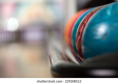 Close-up a group of colored bowling balls in the club.