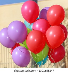 Closeup of a group multicolored balloons at sky background