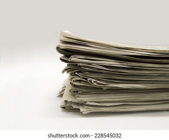 closeup of group of newspapers on a white background