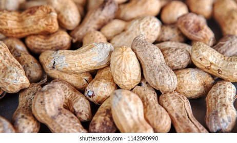closeup of a group of peanuts with nutshells