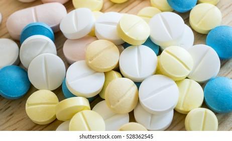 Closeup group of pill medicine, pharmaceutical theme (Selective focus)