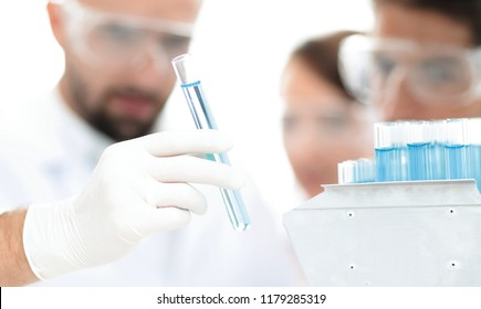 closeup of a group of scientists and pharmacists in the laboratory.