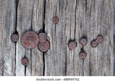 Closeup of grunge dark wood background with rusty nails. wooden texture. surface vintage tone.