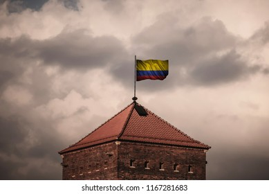 Closeup of grunge flag of Colombia. Flag with original proportions.
