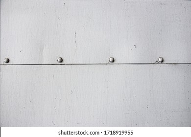 Closeup grunge  gray paint  metal  wall texture  with seam and rivets