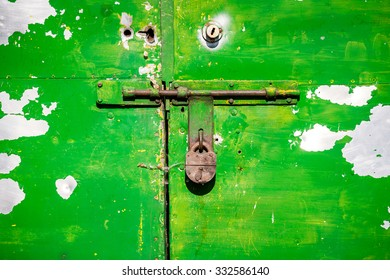 Closeup of grunge metal door with padlock