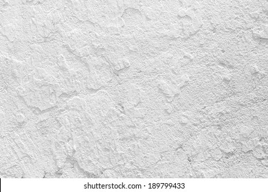 Closeup grunge texture white paint cement wall.