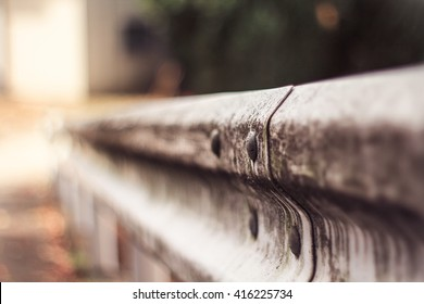 Close-up guardrail by the roadside with some stain on
