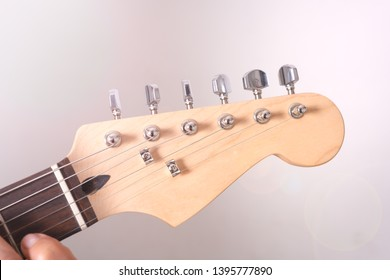 Closeup of a guitar head of a fender guitar