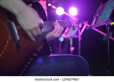 Closeup Guitarist Playing. Men Playing Acoustic Guitar.