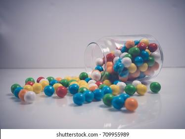 closeup Gum balls in container