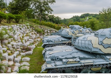 Closeup of gun turret on military tanks with camouflage paint on display in public park near Nonsan, South Korea.