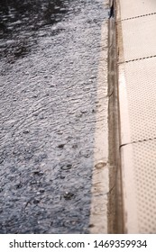 close-up of a gutter of city street during torrential rain
