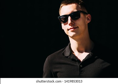 Close-up of a guy in sunglasses looking into the camera