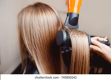 Close-up of hair dryer, concept barber salon, female stylist.