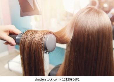 Close-up of hair dryer, concept cut salon, female stylist.