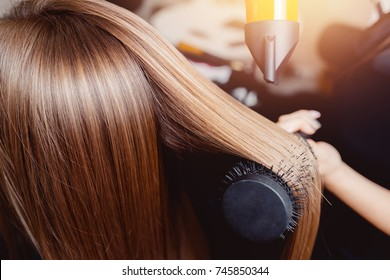 Close-up of hair dryer, concept cut salon, female stylist.