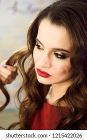 Closeup hairdresser coiffeur makes hairstyle.