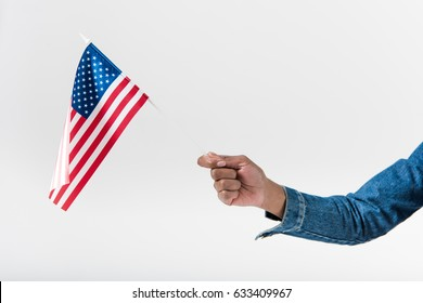 Close-up hand of african american girl holding american flag on stick