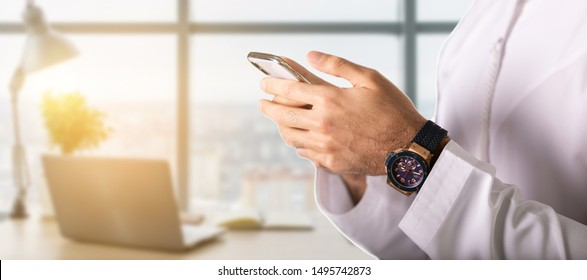 closeup hand of Arab man holding smart phone. technology concept