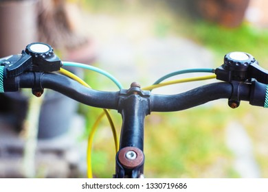 Closeup hand brake mountain bike handle caliper bicycle blurred tree background for Exercise for health image