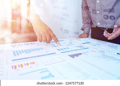 Closeup of HAND of Business Man and Spreadsheet Graph Papers on table. audit tax return on investment analysis Shareholders and Capital Market.Auditor and Analytics concepts
