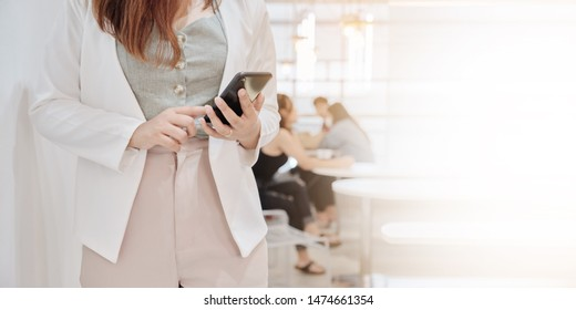 Closeup hand of  business woman on white clothes relaxtion in cafe and using smart phone,socialmedia, technololy online,working Freelance Concept, with copy space for your text