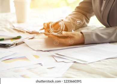 Closeup of Hand of business woman and spreadsheet graph papers on table. Auditor and analytics concepts