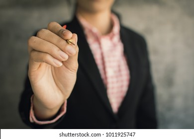 Close-up of hand businesswoman holding dart on loft background,target to success concept