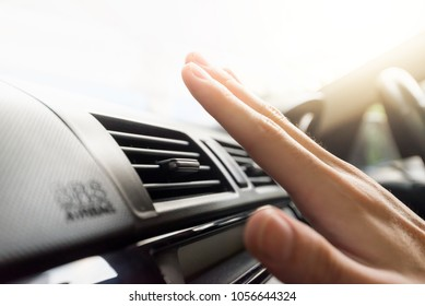 Closeup of hand checking the air conditioner in the car, The cooling system in the car