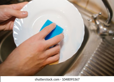 closeup Hand cleaning. Young housewife woman washing dishes in Kitchen