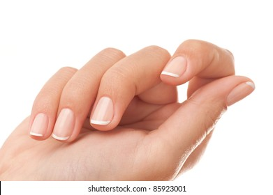 Close-up of woman?s hand with French manicure isolated on white.