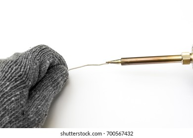 close-up of hand in glove using Soldering iron for heating isolated on white background