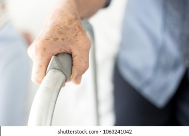 closeup hand holding bar, walk training , stroke patient use walker