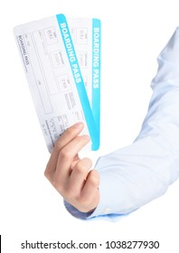 Close-up Of Hand Holding Boarding Pass Over White Background