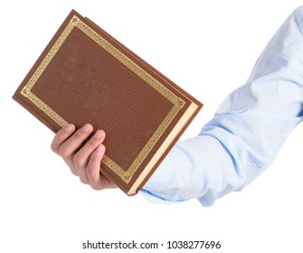 Close-up Of Hand Holding A Book Over A White Background